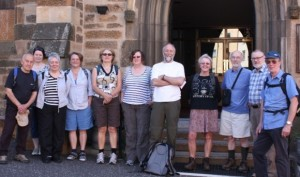 Father Willy Slavin from St Simon's Roman Catholic Church, third from right; Rev Derek Corner, minister at Hamilton URC, second from right; and walkers.